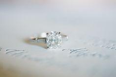 cushion cut platinum engagement ring with baguettes