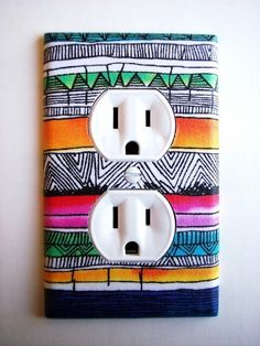 Cut out fabric to fit outlet, and secure with mod podge. For more DiY tips go to this Blog on college dorm decorating.