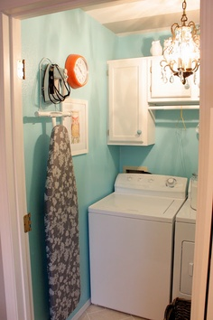 Love the paint color and chandelier.    Laundry room makeover.  I could actually do this in my small laundry room.