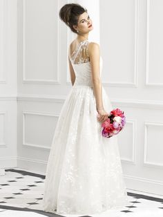 This is pretty! I like the sheerness of the halter. http://thealternativebride.com #wedding
