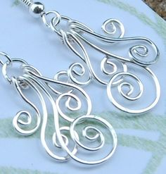 Peacock spiral earrings - pretty -- you can do any number of spirals -- from one to four or five. As a necklace they can be strung on chain, memory wire, leather, cording....