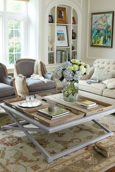 coffee table and bookcase detail in this living room