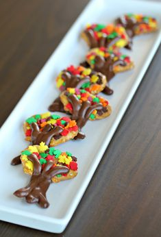 Autumn Trees Pretzel Crisps Thanksgiving Treats #holidayentertaining #thanksgiving #givingthanks #november #holidays #thanksgivingideas #thanksgivingcrafts #thankful #thanks #thanksgivingrecipes www.gmichaelsalon... #diy #crafting #recipes #forthehome #holidaydecorating #holidaydecor #harvest #autumn