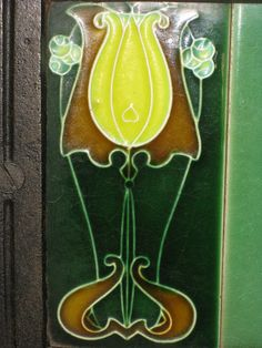 Art Nouveau Fireplace Surround Tile - This beautiful Art Nouveau yellow tulip flanked by white roses features in a fireplace surround in a dining room. The fireplace surround dates circa 1908.