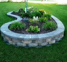 This looks almost identical to the raised flower bed I put in my former back yard.  I miss that flower bed!  I plan to put another one in my new back yard in time.... raised gardens, tree, front yard landscaping, front yards, stone, backyard, flowers, garden beds, raised flower beds