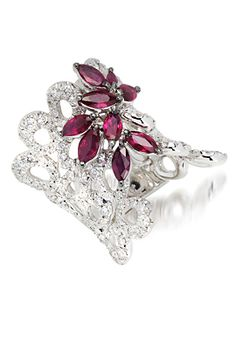 Stefan Hefner An 18K white gold wide lace ring, set with diamonds and rubies.