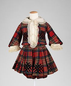Little boy's plaid wool suit with black silk velvet decoration and white cotton collar and cuffs, American, ca. 1860.