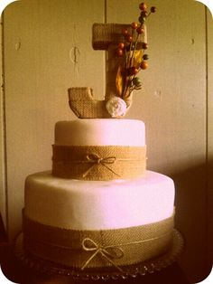 Burlap wedding cake. like it minus the initial