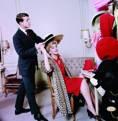 """A young Halston. """"Halston of Bergdorf Goodman"""" with actress Anita Cobb 1965, photo by Ormond Gigli."""