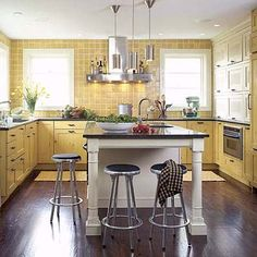 Open space underneath an island might seem like a waste, but in a crowded kitchen it's a great place to stash the stools when no one is sitting on them. |  Photo: Janet Mesic Mackie | thisoldhouse.com