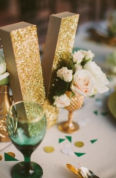 glitter letters + decor. Could  do this with table numbers?