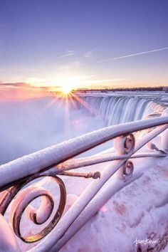 The majestic Niagara Falls in the middle of winter. Blue skies and frozen mist <3