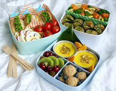 Nice food-artwork with sushi, mini tomatoes, sandwiches and fruits made by gamene.