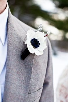Anemone boutonnière. The gray suit adds a vintage look.