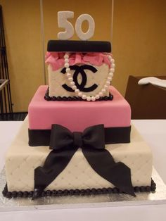 Love this Chanel Cake! I could make some fabulous invitations to match this. #chanel logo, 50th birthday, birthday cake, pink, black, designer cake, little black jacket
