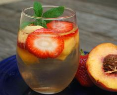 Peach-Strawberry Sangria: white wine, peach schnapps, fresh peach, fresh strawberries