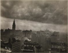 Featured on Gothamist via the MCNY, a view of the Met Life building and lower Manhattan from 34th St during a storm in 1913.