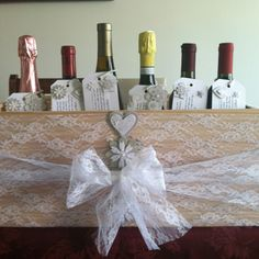 """Engagement party gift: Wine crate decorated & filled with couples """"firsts"""". First Fight, First Home, First Christmas, First New Years, First Anniversary, First Baby. Add a tag with stickers and poems for each """"first"""". I also matched wines to go with each """"first""""."""