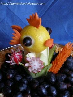 Lemon fish garnish ~ Carrot fins and lips pushed through slits cut in the lemon.  Olive eyes held with toothpicks.