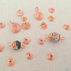 My first wire spiral project is these bead caps.  So far, so good... Learn to make wire spirals and bead caps - Free DIY tutorial at Lisa Yang's Jewelry Blog