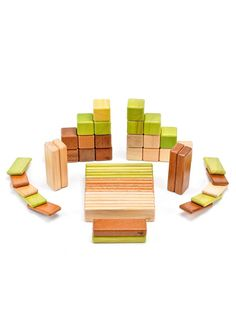 {Blocks by Tegu} They have magnets in the wood blocks. Too cool.