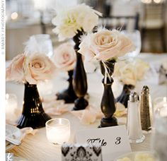 DIY table decor using used candlesticks and floral buds/accessories; so simple to make yet adds elegance and sophistication to event