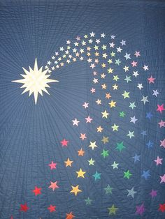 such a cool quilt pattern! all the rainbow stars in this comet (or is it a shooting star?) are great!