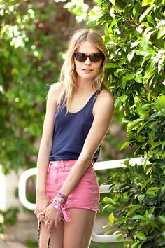 Stay cool in a comfy tank, bright-colored shorts, and chic cat-eye sunglasses
