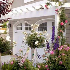 The arching garage doors give the garage a classic and almost Victorian feel. Very pretty!