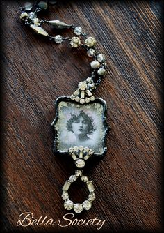 Soldered necklace embellished with vintage jewelry parts, pearls & crystals. Vintage photo is framed with a mirrored glass gilding technique.