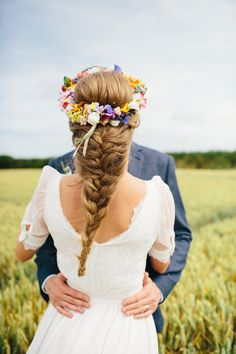 Bride with a Fishtail Braid and a Colourful Floral Crown  | Photography by http://www.richardskinsphotography.co.uk/