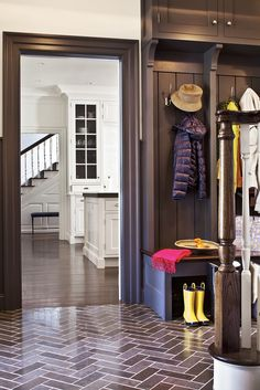 Mudrooms are essential for families with young children! The mudroom is off the kitchen en route to the garage and basement playroom. Open cubbies in addition to a large walk-in closet provide plenty of storage space. The polished herringbone flooring is both traditional and modern. Designed by @alisbergparker Entryway Ideas, Herringbone Floor Mudroom, Mud Rooms, Parker Architects, Laundry Mud, Mudroom Laundry Ideas, Herringbone Floors, Large Mudroom Ideas, Alisberg Parker