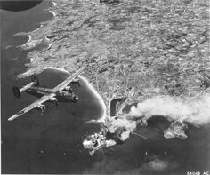 B-24J Liberators of the 565th Bomb Squadron bomb targets in St Malo, France, Aug 13 1944. (US National Archives)