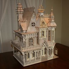 """♥♥♥ Victorian Doll House Birch plywood Laser Cut Kit -- it measures 23"""" wide x 17.5"""" deep x 32"""" high. """"The Doll House has 3 Stories, 4 Rooms, Functioning French doors, as well as a stair case and wrap around porch. This kit comes cut and ready to assemble."""" from VictorianDollhouse  on Etsy"""