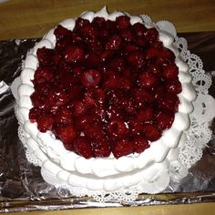 White cake with raspberry filling and topping, whipped frosting.