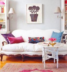 Rashida Jones NYC studio apartment. From domino mag. Sofa. Bookcases. Sconces.