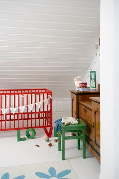 a fun baby room with red & green