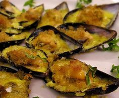 ... recipe.Mussels with bread crumbs and Parmesan cheese baked in oven