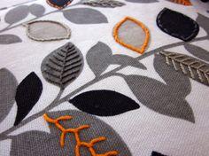 embroidery on printed fabrics.