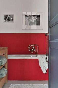 Red accent wall in the bathroom.