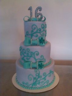 sweet sixteen cake. Loves purple, teal and fleur d syms