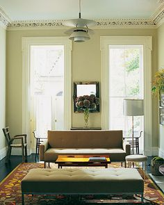 Lively contrast of modern furniture and Victorian architectural details.