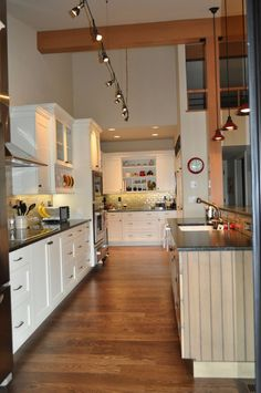 pops of red, white & blue can add a coastal touch to any kitchen. design by Hamilton Redesigns