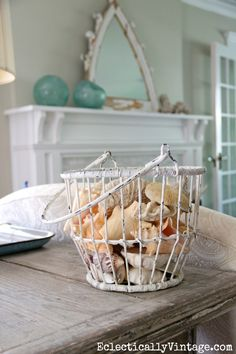Shells in wire basket. More ideas on Completely Coastal:  http://www.completely-coastal.com/2011/09/decorating-with-wire-baskets-from.html shell, beach chic decor, beach hous, sea, beach glass decor, wire baskets, mantl