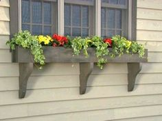 15 Cool DIY Window Boxes With Tutorials. Would be great outside kitchen window instead of looking at brick wall.