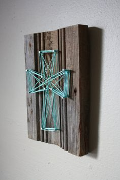 Wood, yarn, & nails...minus the cross design..... But that looks pretty good!