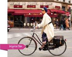 Fashion stylist Catherine Baba cycling in Paris