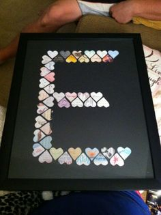 Cut out hearts from all your wedding cards, put them as your last name monogram, glue them to a mat & frame.