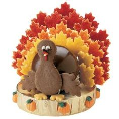 Why not give this symbol of the season a place of honor on your Thanksgiving dessert table? It's a combination of what guest love, all rolled into one. Turkey body is created from a candy plaque made with Candy Melts® shaped in the Sports Ball Pan set. Feathers are made with delicious Roll-Out Cookie recipe and neck and wings take flight with Chocolate Roll-Out Cookie recipe.