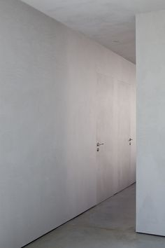 Hidden doors in CG House by ITAI PARITZKI & PAOLA LIANI ARCHITECTS